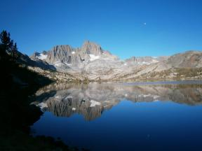 Banner Peak next to Garnet Lake with the moon in the sky